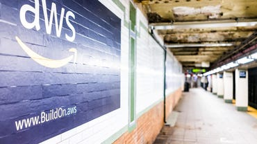 Amazon Web Services AWS advertisement ad sign closeup in underground transit platform in NYC Subway Station, wall tiled, arrow, side