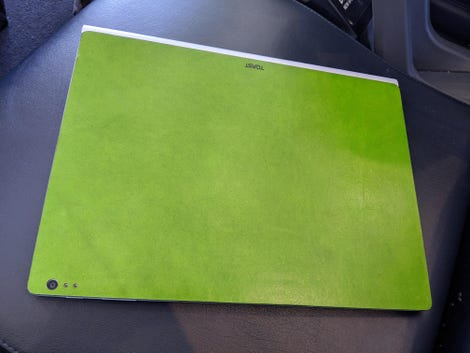A green leather cover on a Surface Book laptop