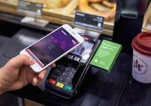 Not waving but paying: Apple Pay and train journeys boost contactless payments