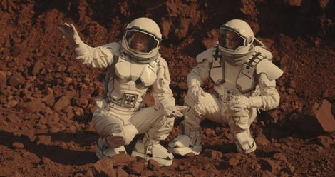Astronauts collecting rock samples on Mars