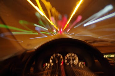blurred-motion-car-drivers-view-traveling-through-tunnel.jpg