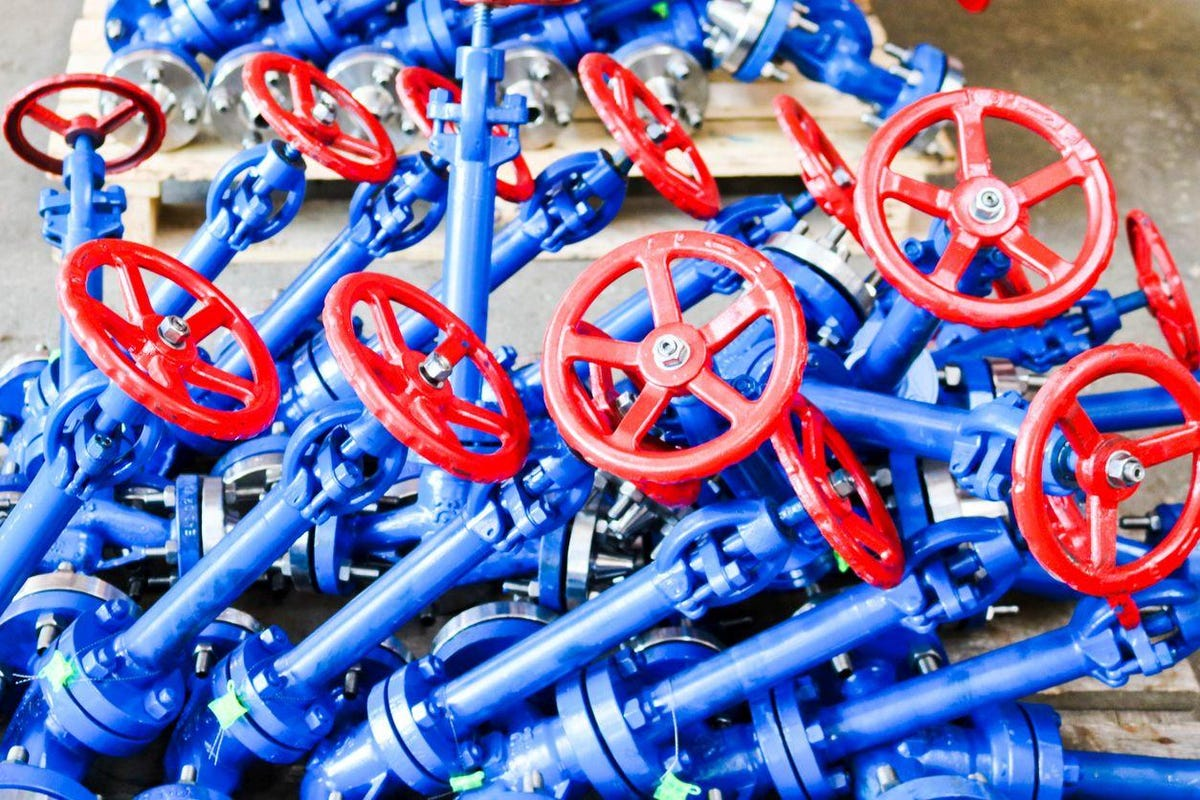 Many new small iron metal shut-off valves, regulating valves with flanges for installation on pipelines, units, vessels at an oil refinery, petrochemical, chemical industrial plant, enterprise
