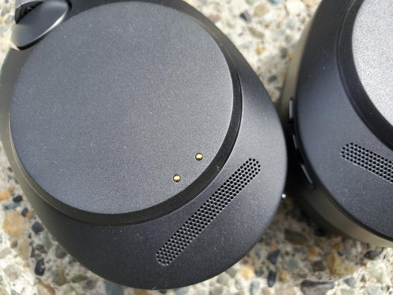 Left ear cup with charging dock connection points