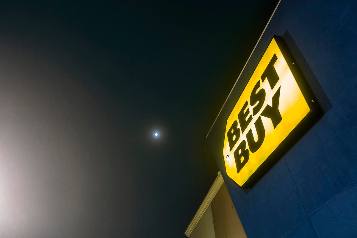 Lit up exterior sign of a local Best Buy store