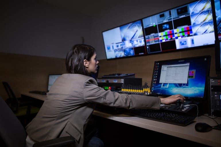 tv-editor-working-with-vision-mixer-in-television-broadcast-gallery.jpg