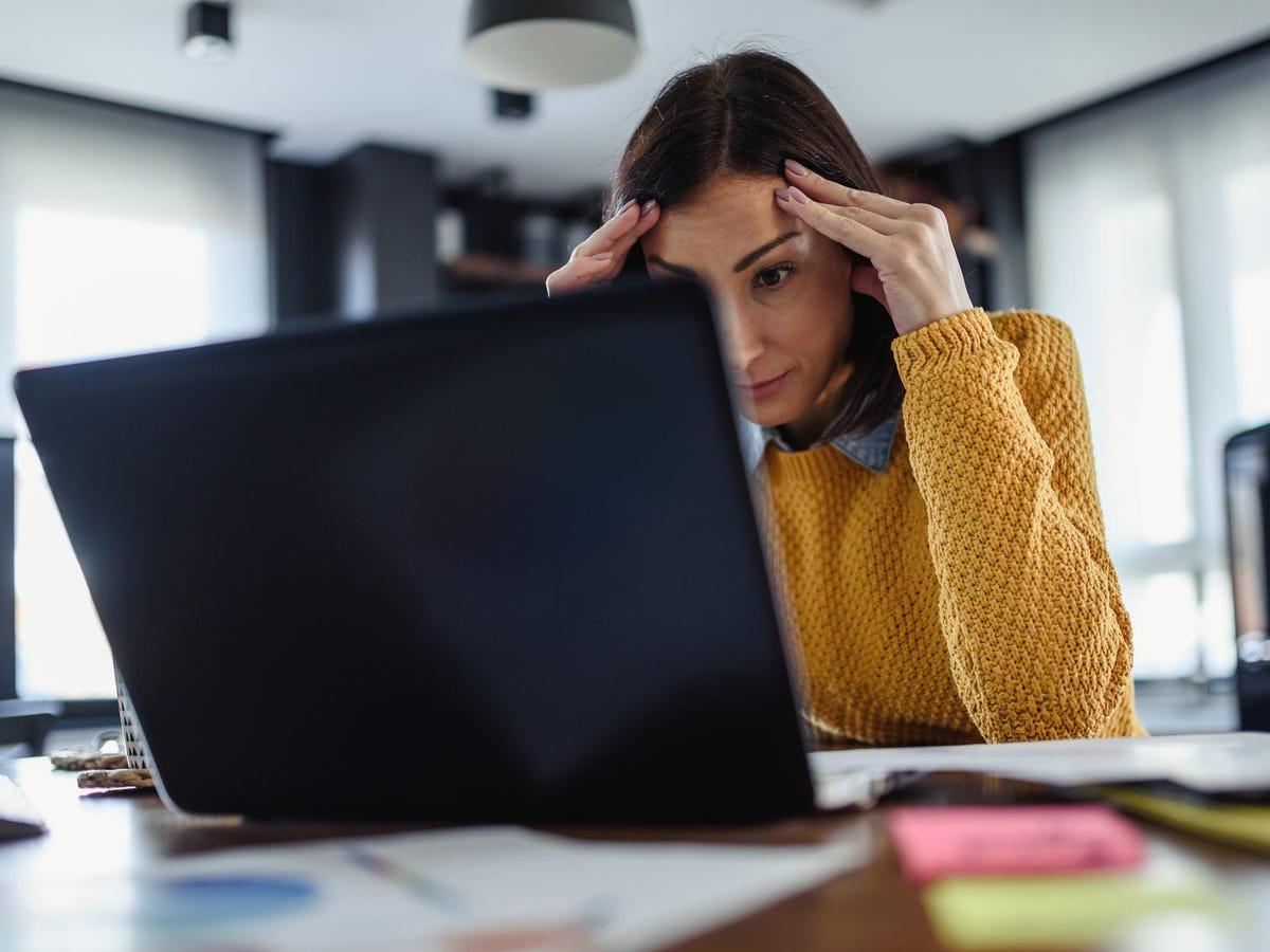 Computer user looking at laptop computer