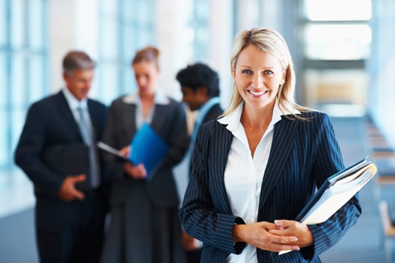 woman-business-spotlight-colleagues-stock-620x414