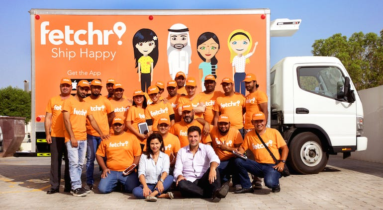 Fetchr's founders with the company's delivery drivers.