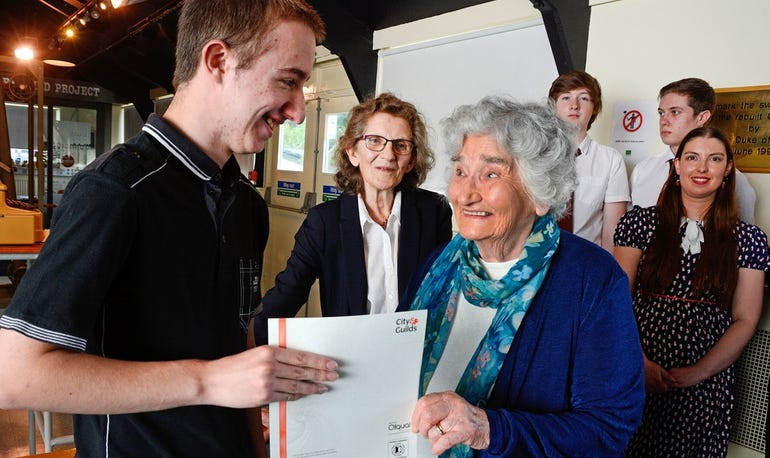 Aaron Revell gets his certificate from Irene Dixon