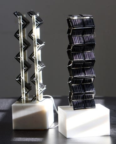 Small-scale models of the three-dimensional solar photovoltaic arrays being tested on an MIT rooftop. (Photo by Allegra Boverman)