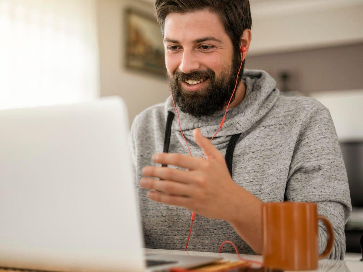 Man smiling making video call.