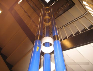 A 7-meter-tall demo/prototype tower stands in a stairwell (Credit: Thoth Technology Inc.)