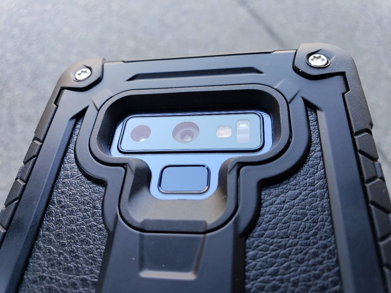 Dual camera and fingerprint scanner opening
