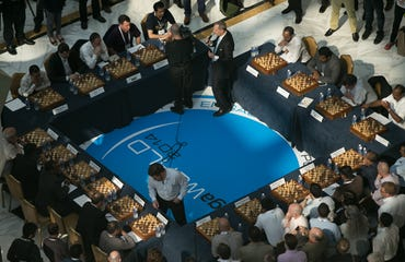 Alan Trefler plays chess