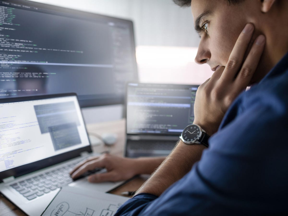 Programmer working in a software develop company office.