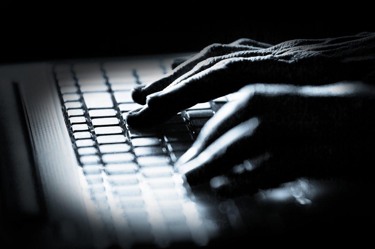 hacker-hands-in-the-shadows-istock.jpg