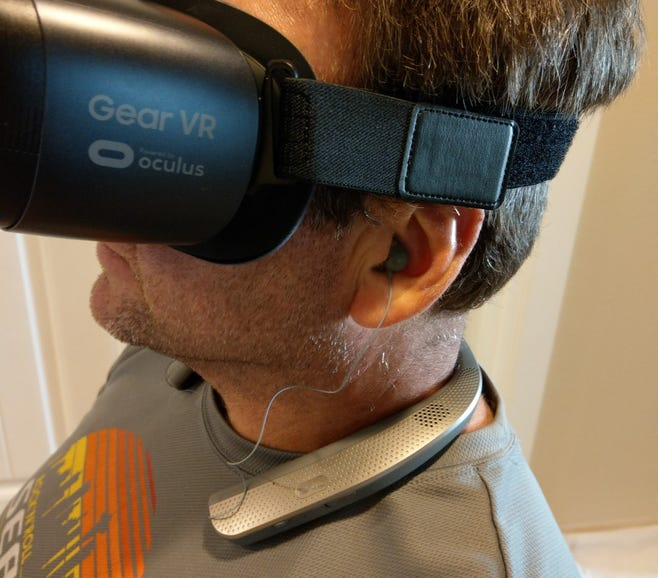 VR experiences with earbuds inserted