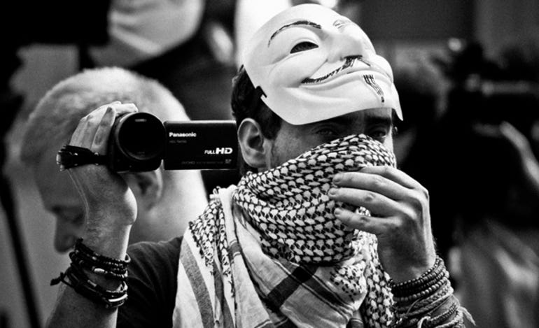 anonymous threatens wikileaks paywall